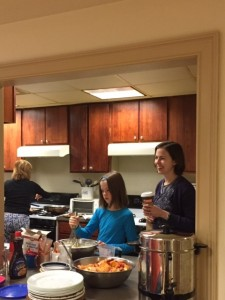 WBC Vice Chair Jen Reagan and her daughter help prepare breakfast at St. Paul's Center.